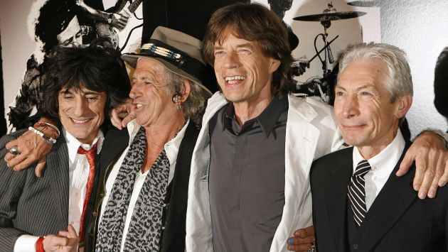 """Rolling Stones band members smile as the group arrives at the premiere of the documentary film """"Shine A Light"""" in New York"""