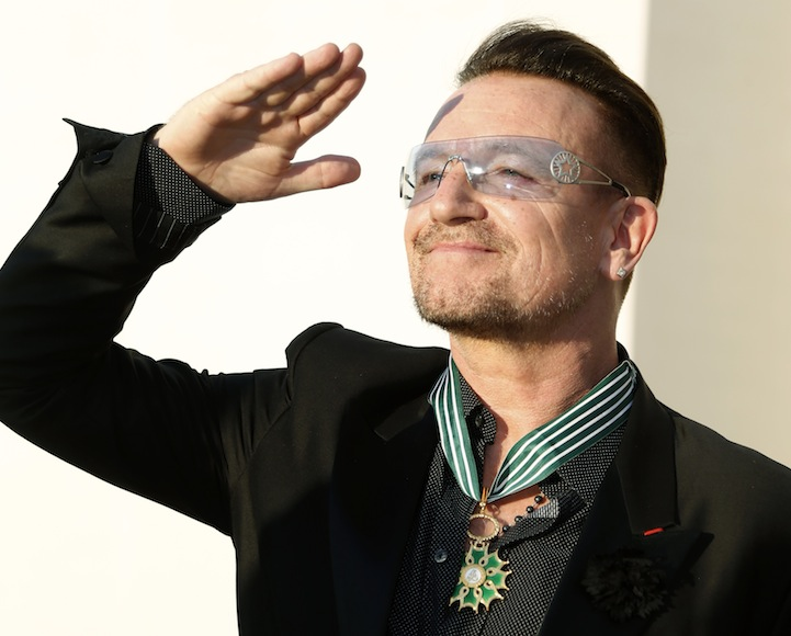 Bono reacts after being awarded as Commander in the Order of Arts and Letters by French Culture Minister Aurelie Filippetti during a ceremony in Paris