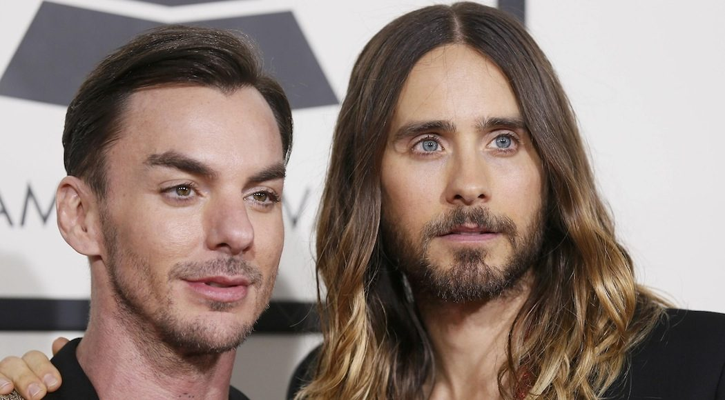 Rock band Thirty Seconds to Mars members Shannon Leto and Jared Leto (L-R) arrive at the 56th annual Grammy Awards in Los Angeles