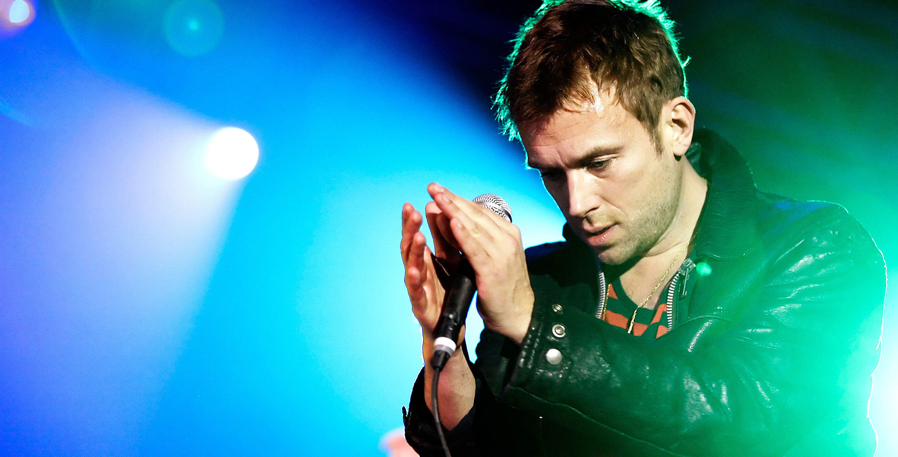 """Singer Damon Albarn - also known as frontman of the band Blur - of the British band Gorillaz performs live during a concert at the Velodrom in Berlin, Germany on November 21, 2010. The concert is part of the """"Escape to Plastic Beach World Tour 2010"""" and promotes the current album """"Plastic Beach"""".  Photo: Monique Wuestenhagen"""