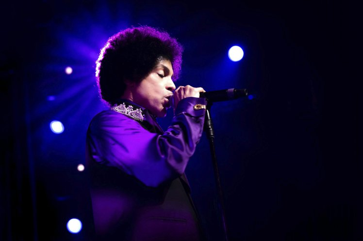 epa05270796 An archive handout image made avialable on 21 April 2016 shows US musician Prince performing on the Stravinski Hall stage during the 47th Montreux Jazz Festival, in Montreux, Switzerland, 14 July 2013.  According to media reports, Prince died on 21 April 2016 at his Paisley Park residence in Minnesota, USA, at the age of 57.  EPA/MARC DUCREST/MONTREUX JAZZ FESTIVAL / HANDOUT MANDATORY CREDIT MARC DUCREST/MONTREUX JAZZ FESTIVAL HANDOUT EDITORIAL USE ONLY/NO SALES