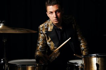 Matt Helders, Drummer arctic Monkeys. At John Henrys studio. Portraits against black inside and outside.