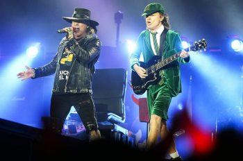 Australian rock band AC/DC's guitarist Angus Young (R) and US singer Axl Rose perform on stage in Vienna, Austria, on May 19, 2016. / AFP / APA / HANS KLAUS TECHT / Austria OUT        (Photo credit should read HANS KLAUS TECHT/AFP/Getty Images)